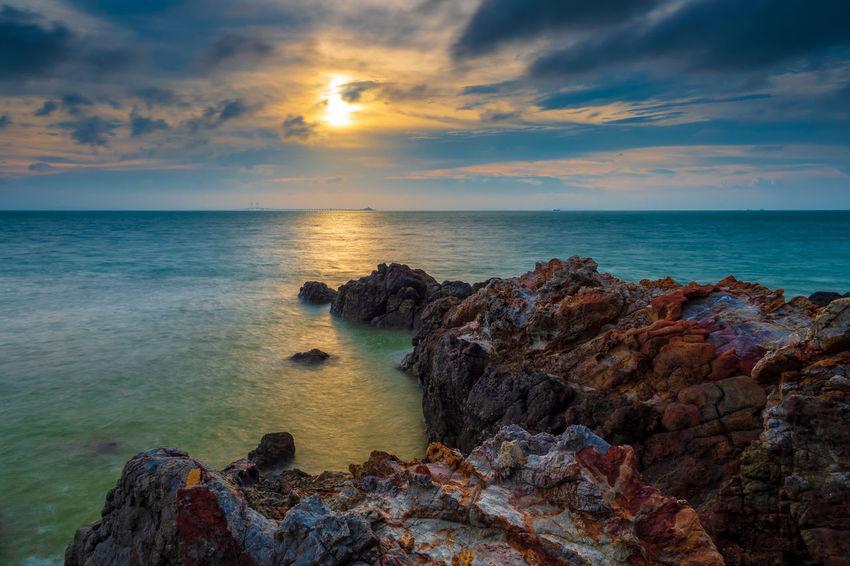Water Sea Sunset Beach Multi Colored Sand Rock - Object Sun Sky Horizon Over Water