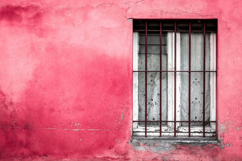 Window on red wall