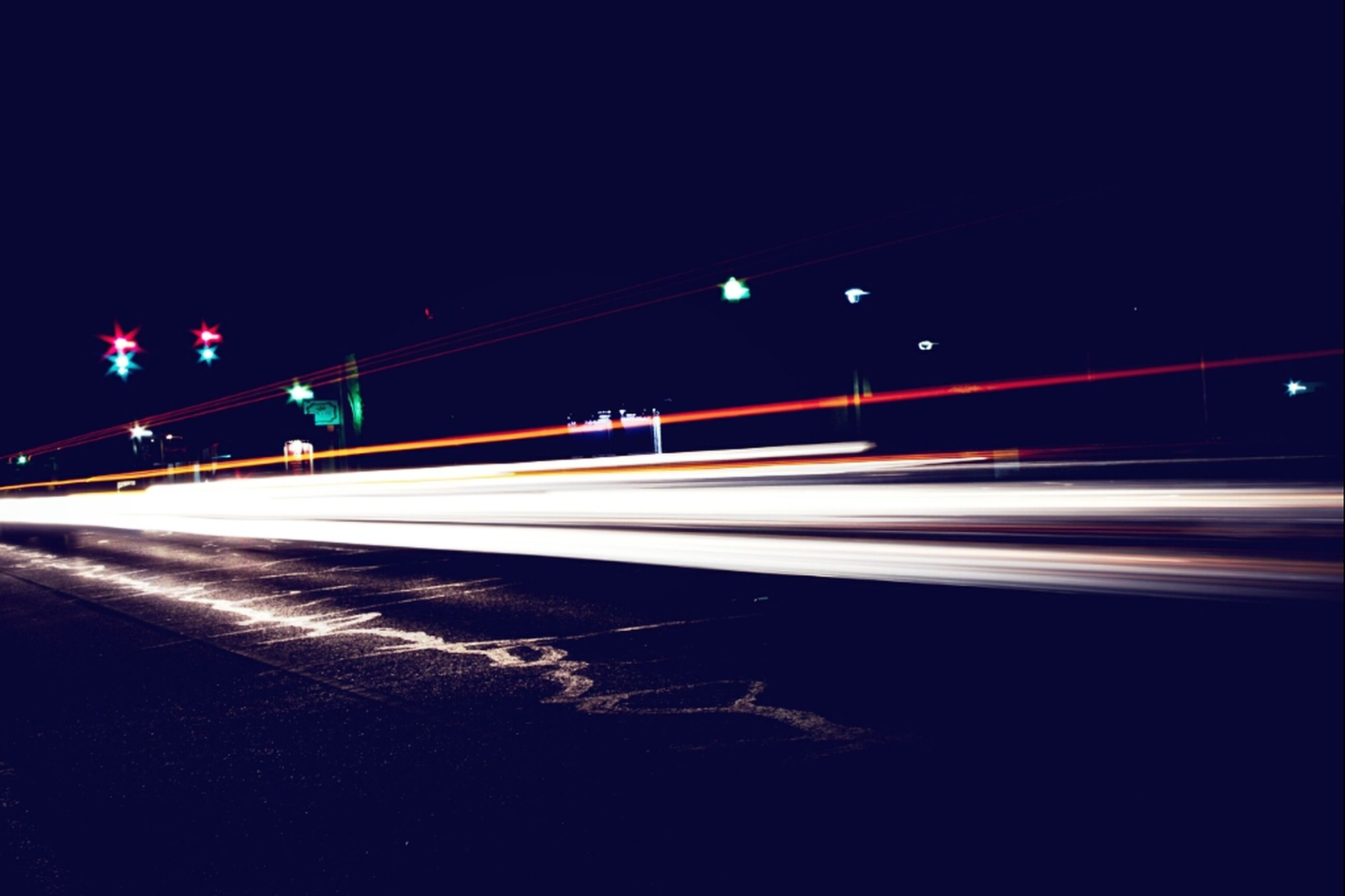 night, illuminated, long exposure, light trail, transportation, speed, motion, street light, road, street, blurred motion, lighting equipment, copy space, clear sky, road marking, light - natural phenomenon, on the move, car, outdoors, the way forward