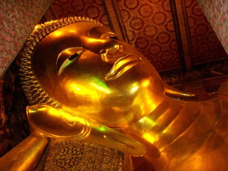 Wat Pho - relaxing Buddha EyeEmNewHere Bhuddha Wat Pho Gold Gold Colored Low Angle View No People Place Of Worship Religion Sculpture Spirituality Statue EyeEmNewHere