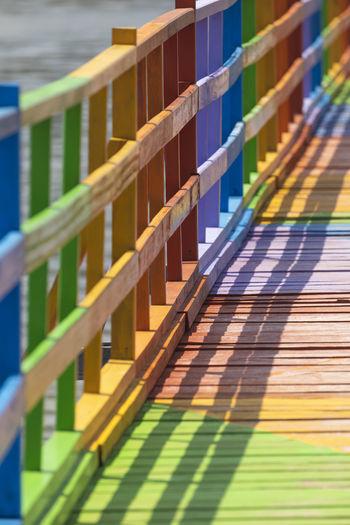 Close-up of multi colored footbridge over river