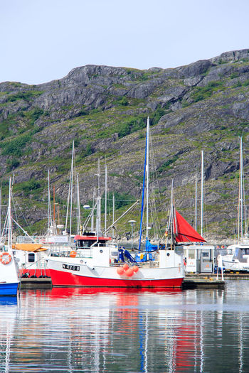 Norway Beauty In Nature Clear Sky Day Fishing Boat Mode Of Transportation Moored Mountain Nature Nautical Vessel No People Non-urban Scene North Norway Outdoors Reflection Sailboat Scenics - Nature Sky Tranquil Scene Transportation Water Waterfront Yacht