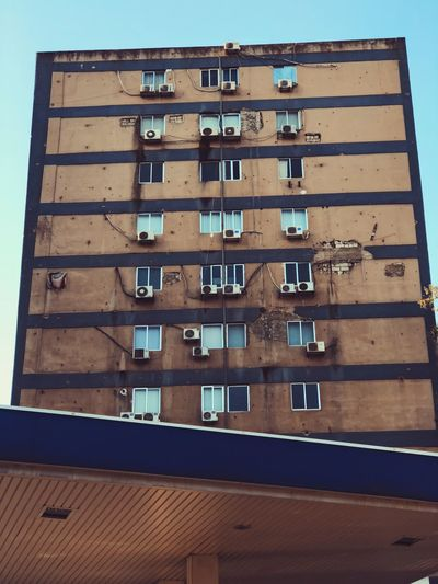 Air Conditioner Apartment Architecture Balcony Building Building Exterior Built Structure City Day Glass - Material In A Row Low Angle View Nature No People Outdoors Residential District Roof Sky Window Wood - Material The Architect - 2018 EyeEm Awards