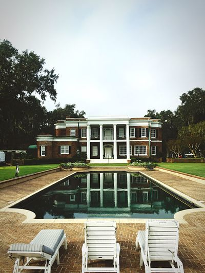 A grande ordeal Architecture Tree Built Structure Building Exterior Sky No People Education Outdoors Day Nature Tranquil Scene Reflections Reflecting Pool Reflections In The Water Columns Brick Building Historical Building