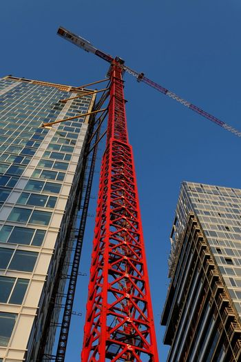 Low Angle View Built Structure Architecture Tall - High Crane - Construction Machinery Building Exterior Sky Construction Industry Machinery Construction Site Building City Nature Skyscraper Tower Office Building Exterior No People Industry Incomplete Blue