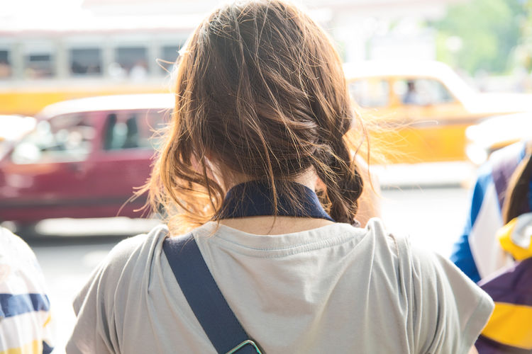 a Back view of Traveler in India Adult Adults Only Asian  City Close-up Day Girl Hair Headshot India Journey Lifestyles Messy One Person Outdoors People Real People Rear View Transportation Traveler Woman Women Young Adult Young Women