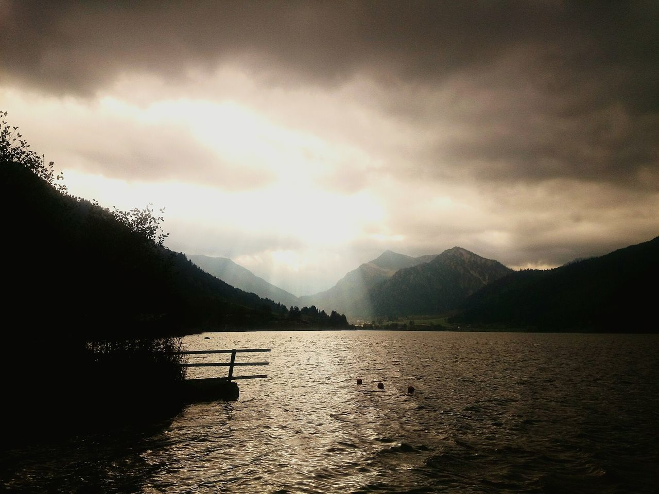 mountain, scenics, water, silhouette, beauty in nature, tranquil scene, nature, tranquility, sky, mountain range, lake, cloud - sky, waterfront, no people, outdoors, day