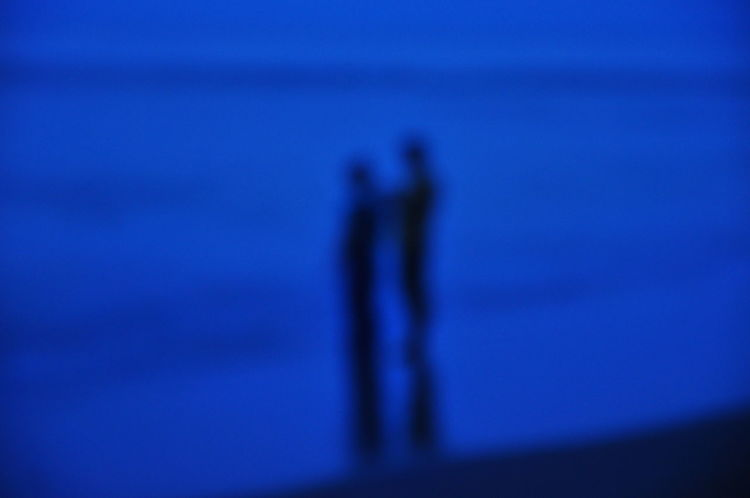 salon photo, 2 person standing at coastline. Beach Beachlife Beauty In Nature Blue Focus On Shadow Leisure Activity Lifestyles Nature Outdoors Outline People And Places Scenics Sea Shadow Silhouette Sky Tranquil Scene Tranquility Water Wooden Post People The Street Photographer - 2017 EyeEm Awards