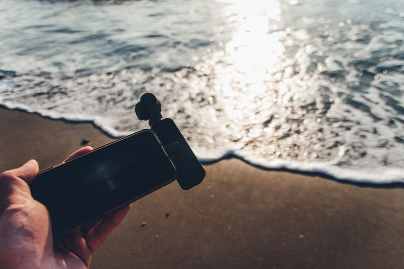 Still Life Gadget Photographer Osmo Pocket DJI OSMO POCKET Dji Photography Mobile Phone Smartphone Holding Hand Human Hand Human Body Part One Person Real People Sea Holding Water Beach Lifestyles Body Part Land Leisure Activity Unrecognizable Person Nature Focus On Foreground Human Finger Personal Perspective Finger Outdoors My Best Photo