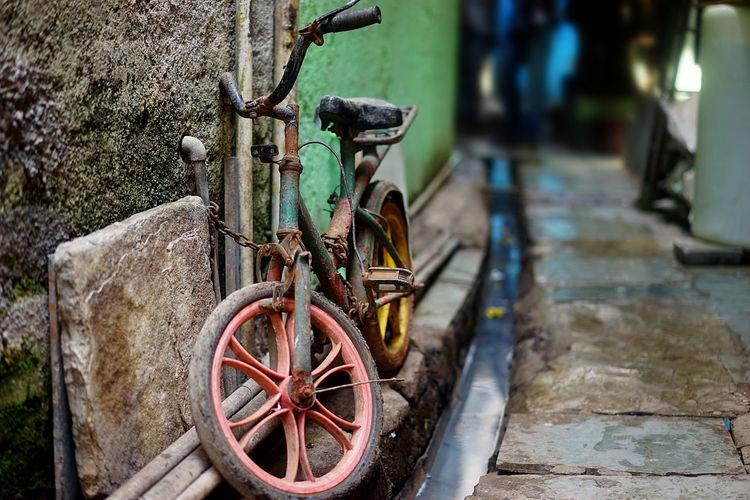 India Inside The Dharavi Slum Mumbai Bike Chained Children's Bike Rotten Rusty