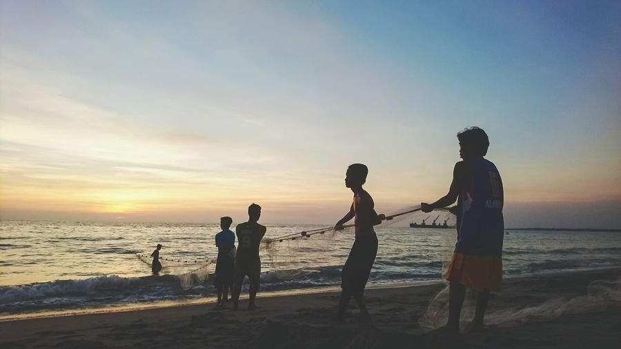 fishermen during sunset at Botolan, Zambales Beach Sunset Silhouette Sea People Togetherness Men Lifestyles Summer Sky Art Is Everywhere Beauty In Nature 2017 Eyeem Awards Landscape Eyeem Philippines Travel Photography Outdoors Travel Photo Dramatic Sky Photooftheday Travelphotography Colour Of Life Botolanzambales Nature The Great Outdoors - 2017 EyeEm Awards Live For The Story