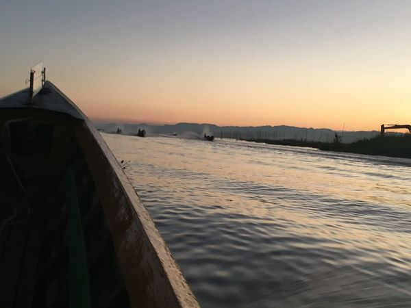 On the lake... Travelling Birmanie Coucher De Soleil Boat Lake View Lake Landscape Built Structure Tranquility Tranquil Scene Beauty In Nature Sky Clear Sky Sea Scenics