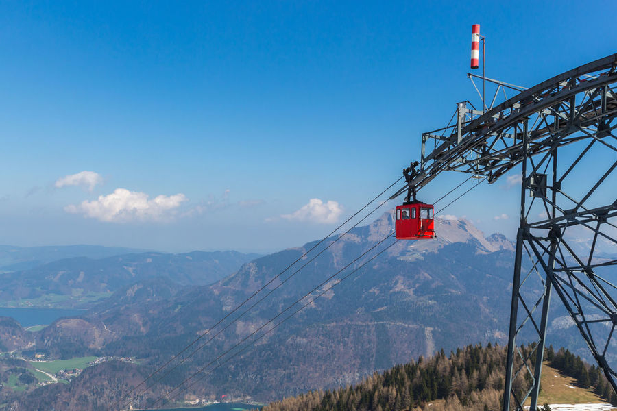 Beauty In Nature Blue Cold Temperature Day Landscape Mountain Mountain Range Nature No People Outdoors Overhead Cable Car Scenics Ski Lift Sky Snow Tranquil Scene Travel Destinations Tree Wolfgangsee