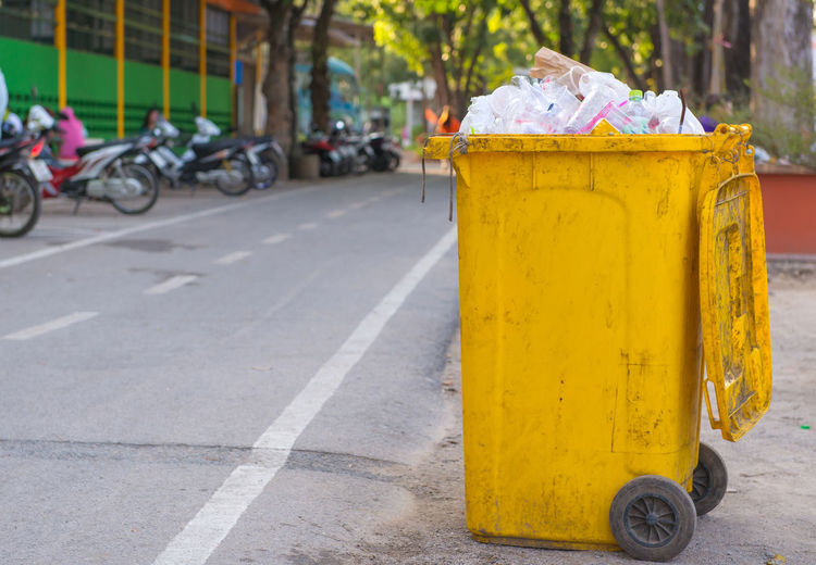 Yellow City Transportation Street Day Focus On Foreground Garbage Bin Road Incidental People Outdoors Mode Of Transportation Recycling Bin Architecture Footpath Land Vehicle Recycling Sidewalk Built Structure Metal