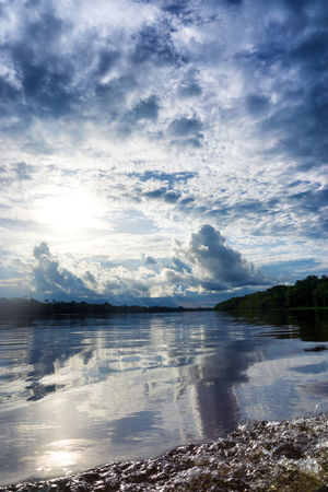 Beautiful sky and reflection on the Amazon River near Leticia, Colombia Amazon Amazonas Amazonia America Colombia Conservation Forest Jungle Landscape Leticia Nature Outdoors Plant Rain Rainforest Reflection River South Tourism Travel Tree Tropical Vegetation Wild Wildlife