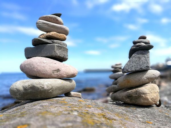Balance Stack Pebble Stability Rock - Object Zen-like No People Sea Beach Cloud - Sky Arrangement Nature Day Close-up Outdoors Water Sky Smartphonephotography Smartphone Photography England, UK England 🌹 Seahouses