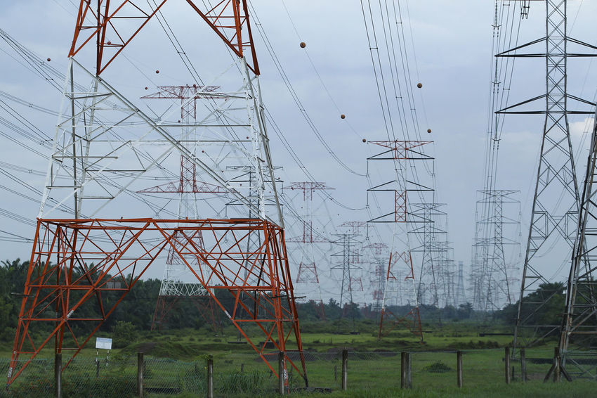 High voltage electric tower Architecture Built Structure Cable Complexity Connection Day Electrical Equipment Electrical Grid Electricity  Electricity Pylon Fuel And Power Generation Industry Low Angle View Metal Nature No People Outdoors Plant Power Line  Power Supply Sky Tall - High Technology