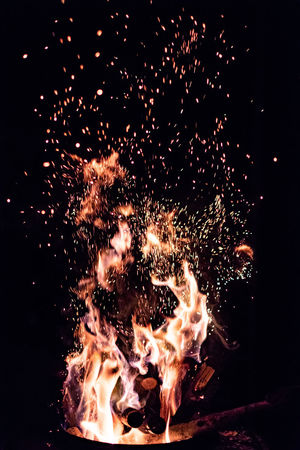 Burning Fire Flame Motion Heat - Temperature Fire - Natural Phenomenon Night Long Exposure Blurred Motion No People Bonfire Glowing Nature Orange Color Sparks Illuminated Event Arts Culture And Entertainment Outdoors Firework Firework Display Firework - Man Made Object Black Background Campfire