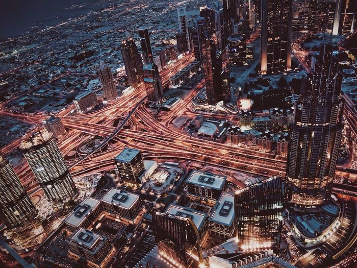 High angle view of cityscape seen through burj khalifa at night