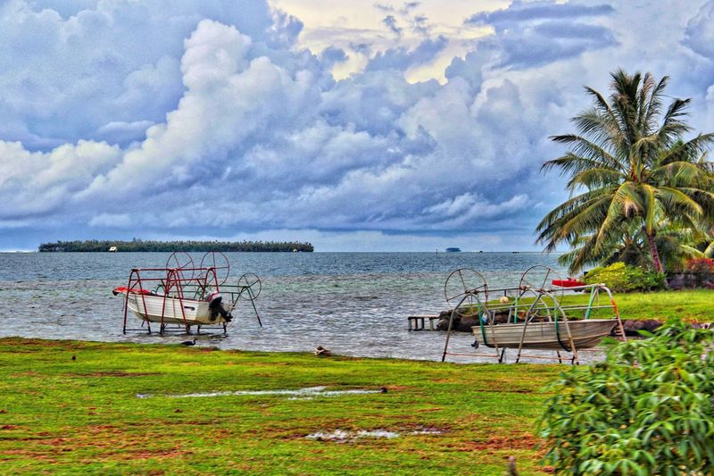 Small fishing boats on Raingora Fishing Boat Water Sky Plant Beauty In Nature Scenics - Nature Sea Land Nature Tree Tranquility Beach Cloud - Sky Tranquil Scene Day Grass Transportation Growth Nautical Vessel Mode Of Transportation No People