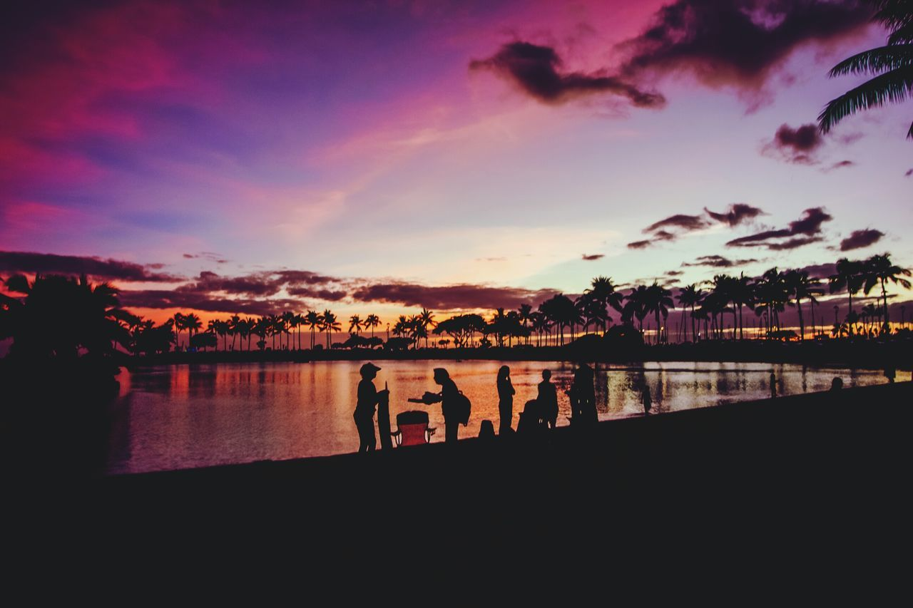 sunset, sky, silhouette, water, cloud - sky, reflection, nature, beauty in nature, real people, scenics, togetherness, tranquil scene, river, tranquility, outdoors, leisure activity, men, built structure, women, architecture, lifestyles, tree, building exterior, day, people