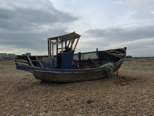 Moody beauty. Moody Sky Atmospheric Clouds Overcast Grey Skies Boat Boat Washed Up Old Boat Battered Boat Wreck Fishing Boat Fishing Boat On Land Textures Dungeness English Seaside Moored Boat England Pebble Beach The Light
