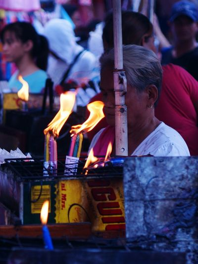 Street Photography Heat - Temperature Burning Flame Religion People Candle One Person Spirituality Quiapo Manila, Philippines Superstition  Church