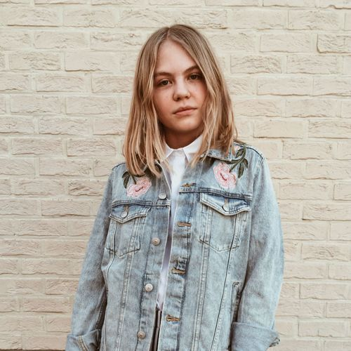 Blond Hair Waist Up Front View One Person Portrait Fashion One Woman Only Young Adult People Brick Wall Sister Girl