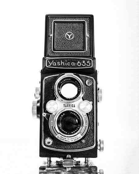 A vintage Yashica dual-film (120 and 35mm) camera 120 Film Camera 1950s Aperture Dial ASA Blackandwhite Blackandwhitephotography Close-up Closeup Copalibertadores Detail Details Dinner Film Film Camera Film Photography TLR Camera Vintage Yashica Yashica 635