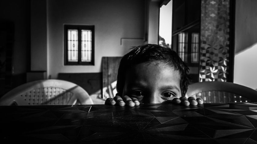 Peek-a-boo. Indoors  One Person Domestic Life Childhood People Headshot Child Day Children Only Home Interior Eyeemphotography Landscape_captures EyeEm Best Shots - Landscape I LOVE PHOTOGRAPHY Black And White Photography Black And White Friday Black And White From My Point Of View Friday B&W Collection Bnw_friday_eyeemchallenge Bnw_sensuality EyeEm Ready   EyeEmNewHere