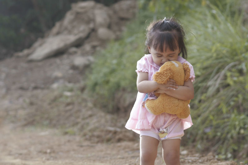 Girl Embracing Stuffed Toy