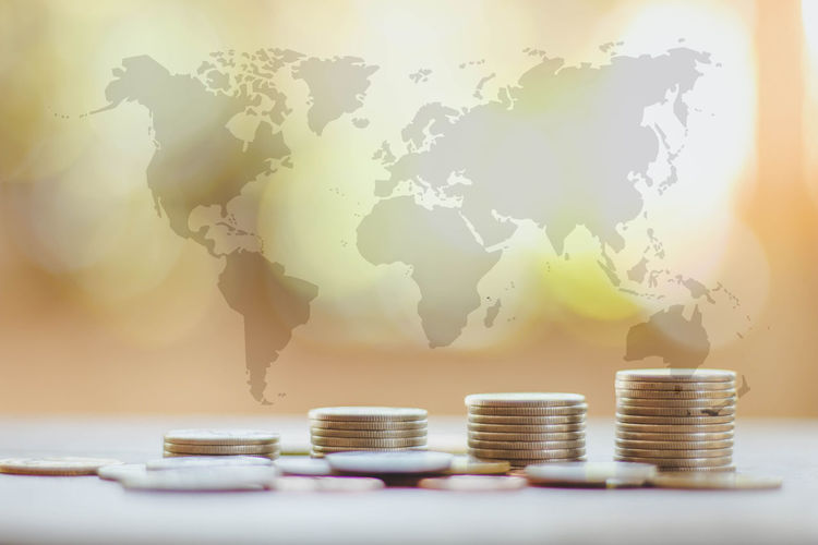 Save money and investment concept with coin stack growing graph with sunlight and world map Economy Growth Light Loan  New Accounting Business Cash Coin Concept Currency Economy Finance Keep It Blurry Money No People Save Stack Wealth World Map