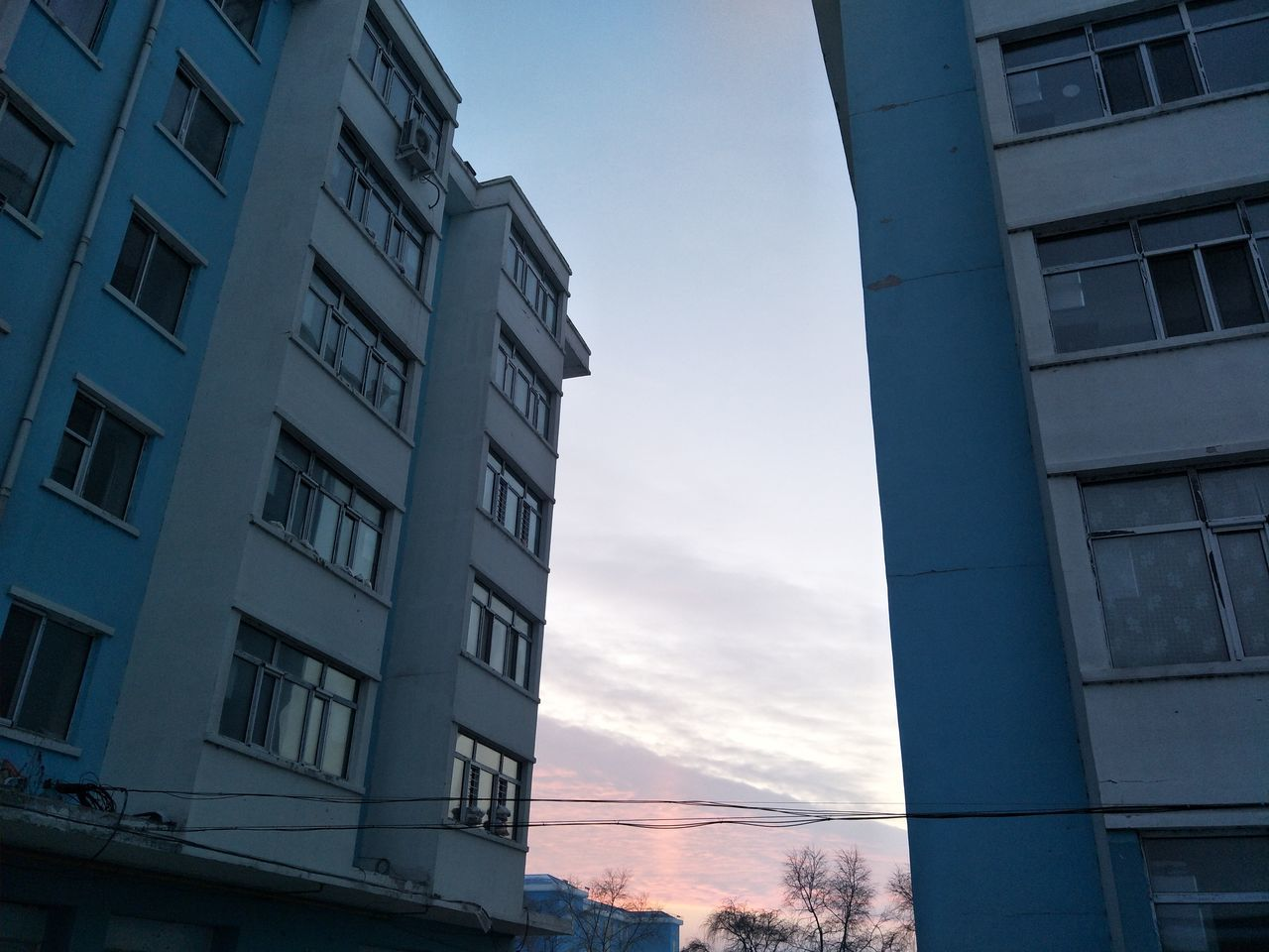 architecture, building exterior, built structure, low angle view, window, no people, day, sky, outdoors, residential building, city, nature