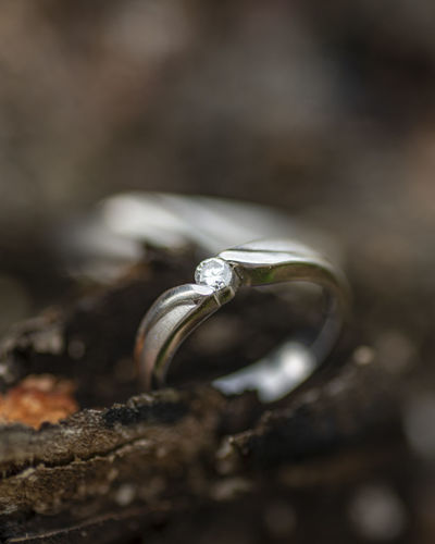 Close-up of wedding rings on rock