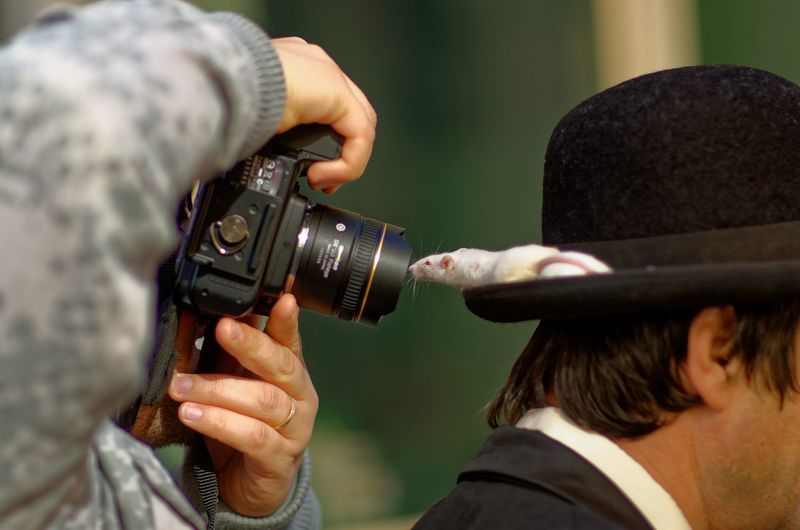 Camera - Photographic Equipment Camera Operator Close-up Day Holding Human Hand Leisure Activity Lifestyles Men Mice Occupation One Person Outdoors People Photographer Photographing Photography Themes Real People