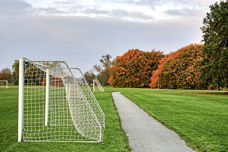 Goal posts on playing field against sky