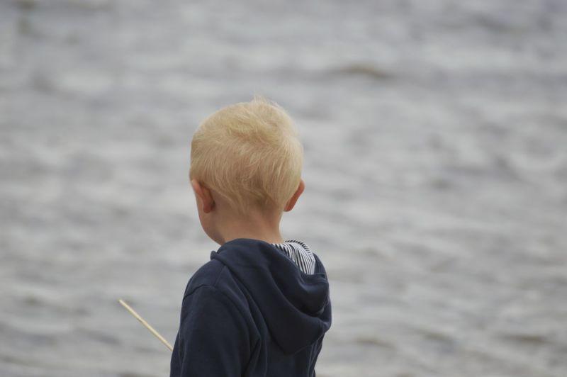 Rear View Of Boy At Beach
