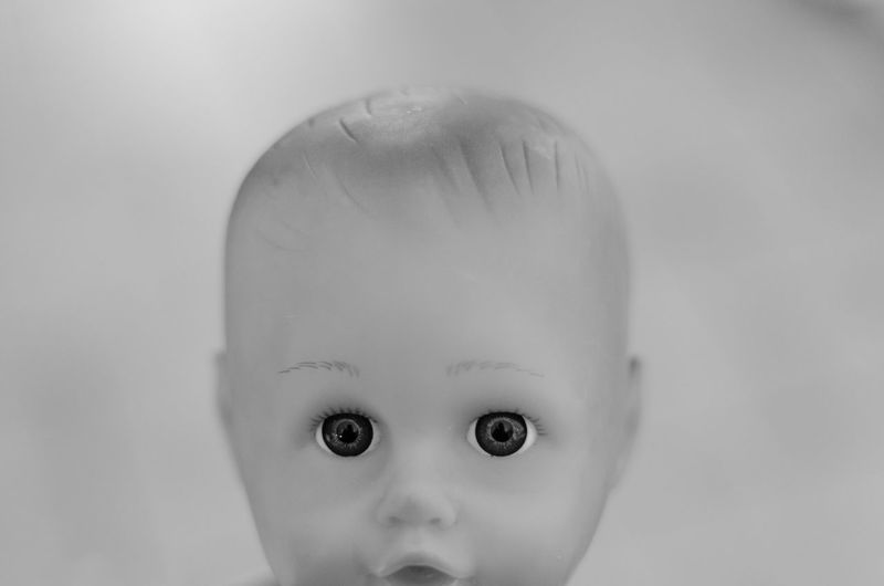 Close-Up Of Doll Against White Background