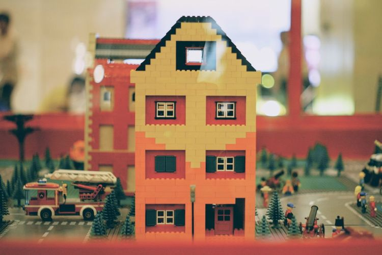 Architecture Built Structure Building Exterior Building Residential District Mode Of Transportation Car Motor Vehicle House Outdoors Window Red Transportation Toy Day Incidental People City Focus On Foreground Nature Apartment