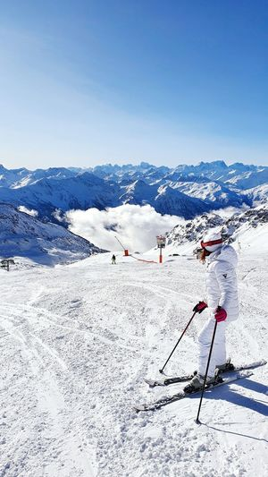 Woman skiing on snowcapped mountain during winter