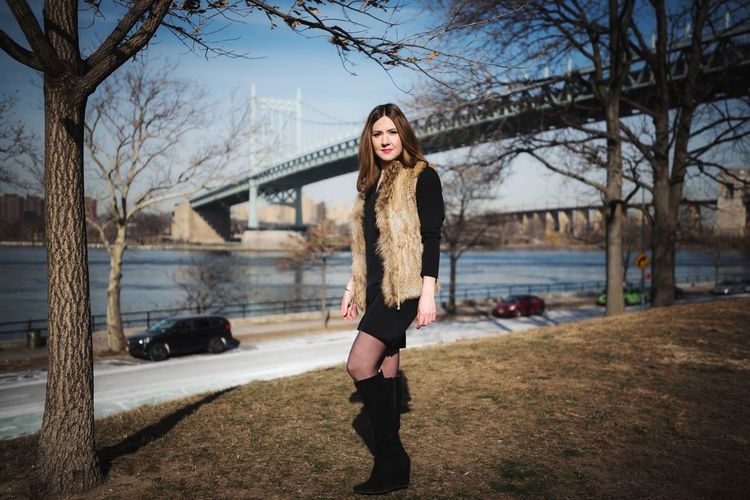 Fashion NYC Lifestyles Only Women Outdoors Bare Tree One Person Adult One Woman Only Adults Only Young Adult One Young Woman Only Sky Beautiful Woman Beauty People Tree Women Lifestyles Nature Young Women City Day