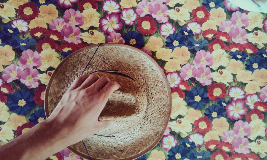 Human Hand Human Body Part Holding Real People Close-up One Person People Day Daytime Photography Daytime Terrace Straw Hat Sun Hat Hat Flower Patterns Flower Pattern Outdoors Multi Colored Home Is Where The Art Is