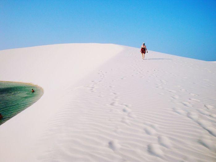 Man on sand against clear sky
