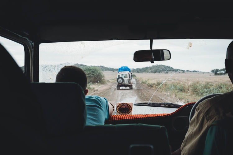 Savannah road Adult Bad Roads Car Car Interior Day Driving Headshot Journey Look At The Road Nature On The Move Passenger Seat People Rear View Road Savannah Road Serenity Sky Tanzania Togetherness Transportation Travel Vehicle Interior Summer Road Tripping