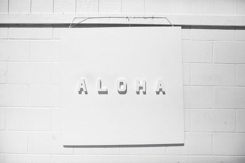 Aloha Capital Letter Close-up Communication Day Indoors  Message No People Public Restroom Restroom Sign Single Word Text Wall - Building Feature Western Script White Background White Color