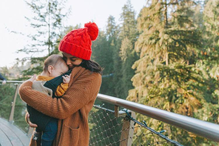 A mother and baby cuddling in the forest. Forest Trees Nature Beautiful West Coast Pacific Northwest  Woman Mother Baby Cuddling