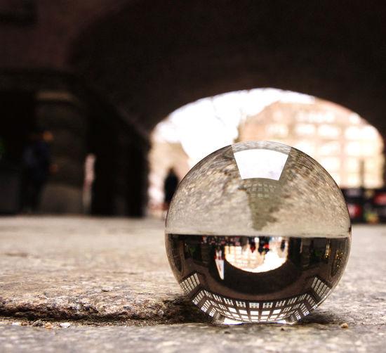 Close-up of illuminated crystal ball on street
