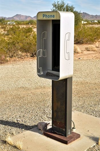 outdated technology shell of phone booth in desert once held a coin operated pay phone Vintage Technology Abandoned Close-up Communication Day Empty No People Outdated Outdated Tech Outdoors Pay Phone Phone Booth Retro Style Sky Vintage Telephone