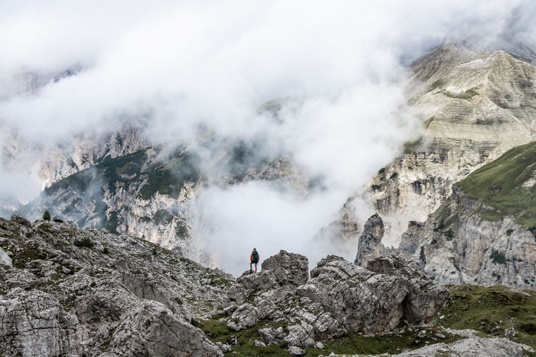 Hiking in front a fantastic mountain scenery with clouds and massive rocks, Dolomites, Italy. Mountain Beauty In Nature Solid Rock - Object Rock Scenics - Nature Leisure Activity Day One Person Nature Landscape Non-urban Scene Lifestyles Mountain Range Environment Tranquil Scene Activity Tranquility Adventure Outdoors Hiking Hikingadventures Hiker Hikerslife Hiking Trail My Best Photo