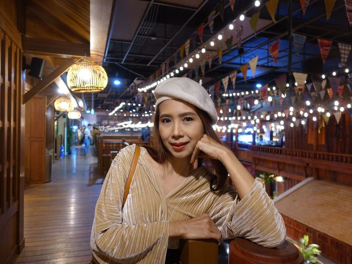 Portrait of smiling woman standing in restaurant